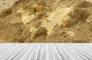Sand texture surface with Wood terrace and world map Stock Photos