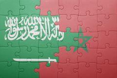 Puzzle with the national flag of morocco and  saudi arabia. Stock Photos
