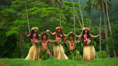 Young strong males with female group of Tahitian hula dancers performing outdoor Stock Footage
