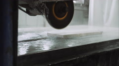 Saw machine makes a cross-section on the marble stone plate , close up Stock Footage