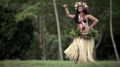 Young Polynesian Tahitian female hula dancer in grass skirt performing outdoor Stock Footage