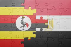 Puzzle with the national flag of uganda and egypt. Stock Photos