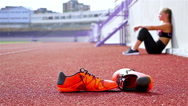 Teenager girl takes breath tired exhausted disappointed after running on stadium Stock Footage