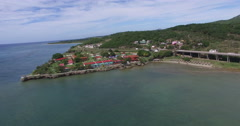 Bird's-eye view from drone to landscape of peninsula, bridge with main city road Stock Footage