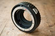 Extension ring for lens  camera on wooden background Stock Photos