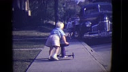 1946: toddler with tricycle being picked on by an older boy DETROIT, MICHIGAN Stock Footage