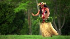 Single beautiful young Polynesian female hula dancer in Paradise entertaining  Stock Footage