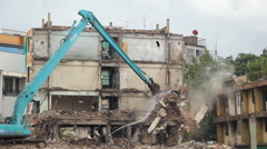 Excavator machinery working on demolition old building Stock Footage