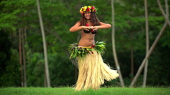 Barefoot Tahitian female in hula skirt and flower headdress performing  Stock Footage