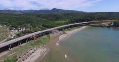 Bird's-eye view from drone to landscape of peninsula, bridge with main city Stock Footage
