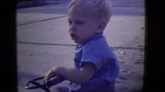 1946: blonde cute kid playing in street with neighborhood friends DETROIT Stock Footage