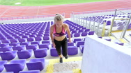Teenager girl athlete running up the stairs in a stadium, slow motion Stock Footage