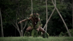 Young Tahitian male performing war dance style hula dance outdoors barefoot  Stock Footage