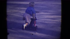 1946: gang of cute kids riding bikes and tricycles down the sidewalk DETROIT Stock Footage