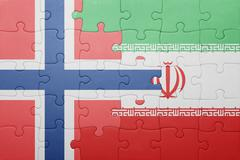 Puzzle with the national flag of norway and iran Stock Photos