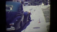 1946: cute blonde kid appears from side of car DETROIT, MICHIGAN Stock Footage