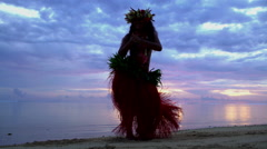 Young graceful Tahitian Polynesian female dancing on the beach at sunset Stock Footage