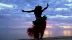 Polynesian girl in traditional grass skirts and flower headdress dancing  Stock Footage