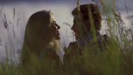 Portrait of happy couple on a meadow smiling and kissing Stock Footage