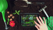 4k Gardening Composition of Hands Searching on iPad Stock Footage