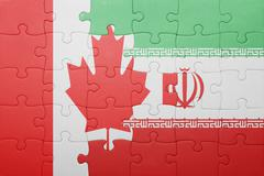 Puzzle with the national flag of canada and iran Stock Photos