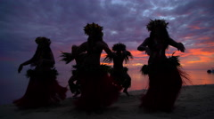 Young males and females in a group of Tahitian hula dancers performing at sunset Stock Footage