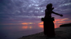 Young Polynesian female Tahitian hula dancer performing at sunset on ocean beach Stock Footage