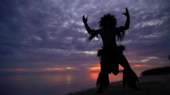 Young Tahitian male at sunset performing war dance style hula dance outdoors Stock Footage