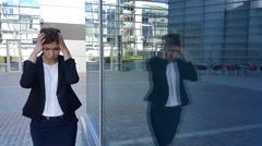 Frustrated young business woman walking near office Stock Footage