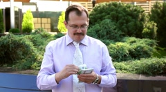 Middle age businessman counts euro Stock Footage