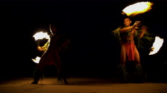 Polynesian male Fire dancers performing with spinning flaming torches  Stock Footage