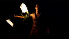Illuminated flaming torch male Fire dancer performing the Art of Fire dancing  Stock Footage
