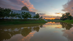 Majestic sunset sky over a mosque by the lake with perfect reflection. Stock Footage