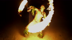 Male Fire dancer with illuminated spinning flaming torch performing the Art  Stock Footage