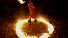 Male Polynesian Fire dancer performing in a Ring of Fire while spinning  Stock Footage