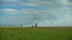 Rural scene of stubble burning for crop rotation on farmland in North Island New Stock Footage