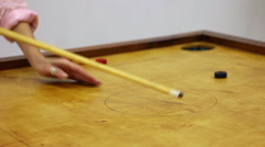 Friends playing carrom table game, girl scoring winning points, leisure time Stock Footage