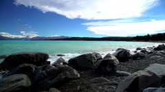 Natural beauty of turquoise color water and waves on Lake Tekapo Mackenzie Basin Stock Footage