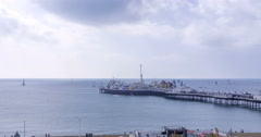 Sailing boats in a race around Brighton pier Stock Footage