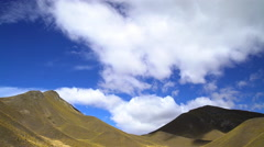 Cloudscape photography over natural beauty of open range farmland Southern Alps Stock Footage