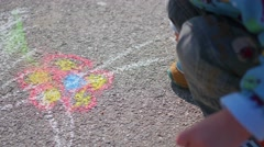 Child draws with chalk on the pavement Stock Footage