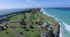 Bird's-eye view from drone to landscape of peninsula, extensive field with green Stock Footage