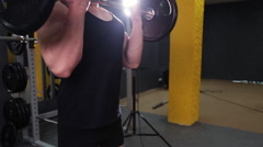 Man doing weight lifting in gym Stock Footage