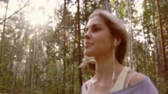 Portrait of pretty smiling young woman jogging in nature and enjoying fresh air Stock Footage