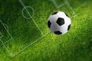 Soccer ball on green stadium Stock Photos