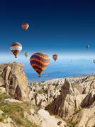 Hot air balloons flies in clear deep blue sky in Cappadocia Kuvituskuvat
