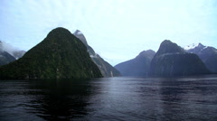 UNESCO World Heritage Site of Milford Sound Piopiotahi with Mitre Peak in South Stock Footage