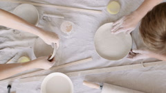 Girl sculpts clay dishes Stock Footage