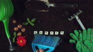 4k Gardening Composition of Scrabble Word Garden in Soil Stock Footage