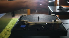 Turntable playing music with hand with backlight. Oldschool hipster concept Stock Footage